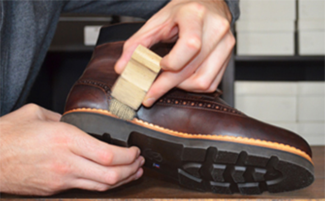 Greasing the blake stitching of the shoe with a welt brush extends its life and ensures that the outsole sticks to the upper.